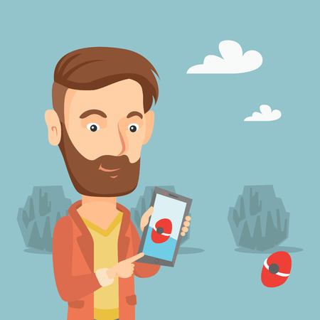Hipster man with the beard playing action game on smartphone. Young man playing with his mobile phone outdoor.