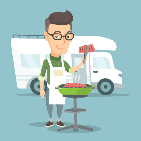 Man with cooking meat on barbecue on the background of camper van.