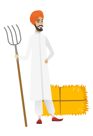 Young hindu farmer in headscarf standing with a pitchfork on the background of hay bales. Full length of farmer holding a pitchfork. Vector flat design illustration isolated on white background.