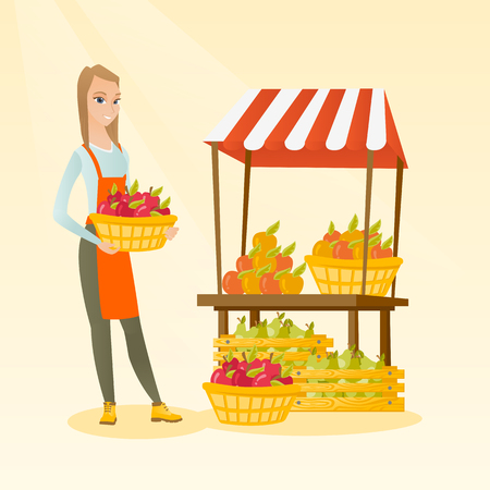 Young caucasian greengrocer holding box full of apples. Smiling female greengrocer standing in front of grocery stall with vegetables and fruits. Vector flat design illustration. Square layout.