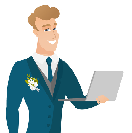 Young caucasian groom using a laptop.