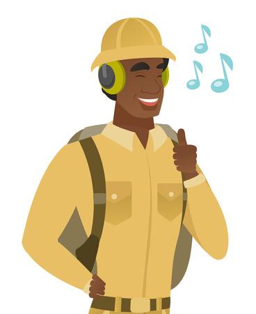 African traveler listening to music in headphones.