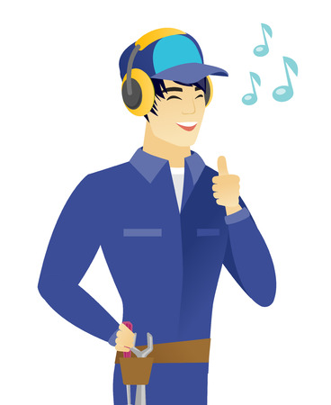 Young asian mechanic listening to music in headphones. Happy smiling mechanic with his eyes closed listening to music in headphones. Vector flat design illustration isolated on white background.