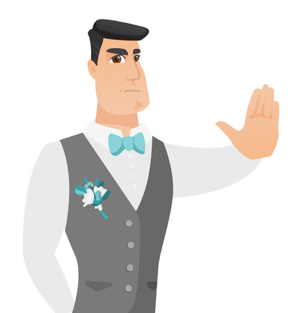 Young caucasian groom showing stop hand gesture.