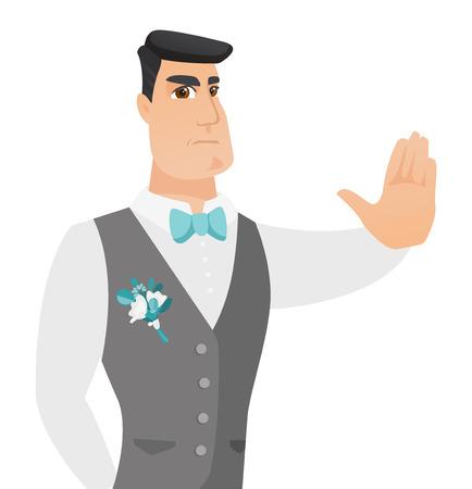 Young caucasian groom showing stop hand gesture.
