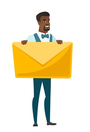 Smiling groom holding a big envelope.
