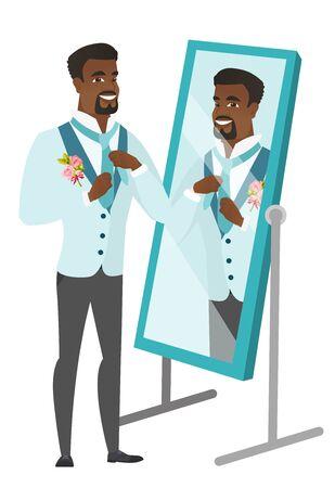 Groom looking in the mirror and adjusting tie.