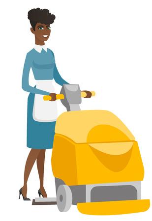 Trabajador africano que limpia el piso de la tienda con la máquina. Foto de archivo - 81739466