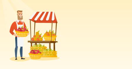 Greengrocer holding box full of apples.