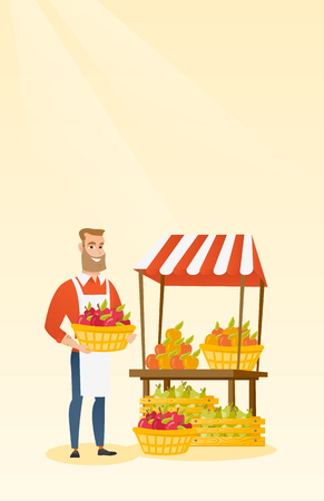 Young caucasian greengrocer holding box full of apples. Hipster greengrocer with beard standing in front of grocery stall with vegetables and fruits. Vector flat design illustration. Vertical layout. Illustration