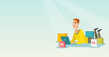 Young caucasian man using laptop for online shopping. Smiling man lying with a laptop and shopping bags around him. Happy man doing online shopping. Vector flat design illustration. Horizontal layout.