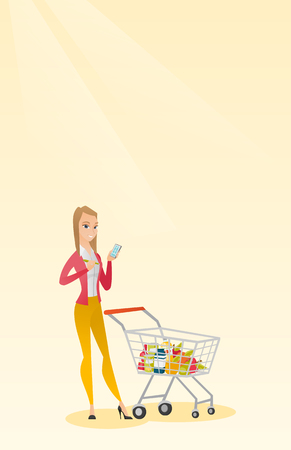 mujer en el supermercado: Young caucasian woman standing near supermarket trolley full of products and holding a calculator in hand. Woman checking prices on the calculator. Vector flat design illustration. Vertical layout.