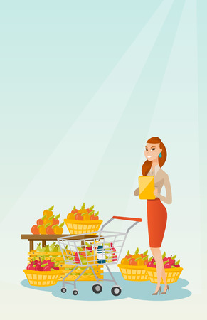 checking: Caucasian woman standing near trolley with products and checking shopping list on the background of supermarket section with vegetables and fruits. Vector flat design illustration. Vertical layout.