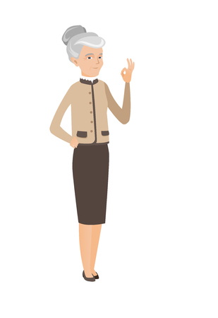 alright: Senior caucasian business woman showing ok sign