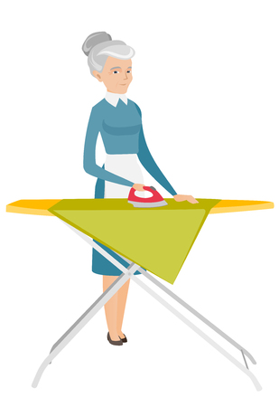 ironing: Caucasian maid ironing clothes using an iron on the ironing board after laundry. Senior hotel maid ironing clothes on the ironing board. Vector flat design illustration isolated on white background.