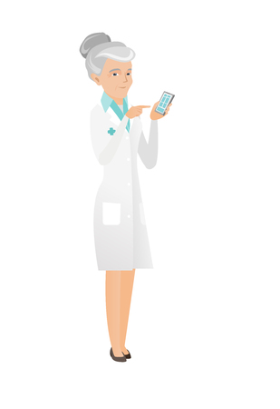 Caucasian doctor in medical gown holding mobile phone and pointing at it. Senior doctor with mobile phone. Doctor using mobile phone. Vector flat design illustration isolated on white background. Illustration
