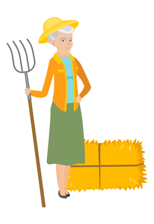 Senior caucasian farmer standing with a pitchfork on the background of hay bales. Full length of farmer holding a pitchfork. Vector flat design illustration isolated on white background.
