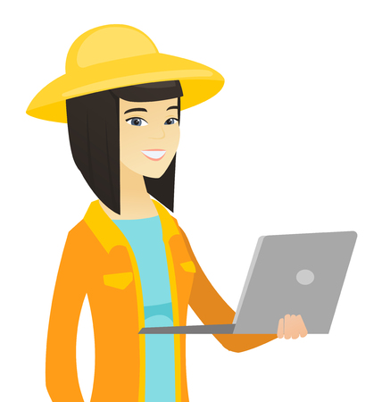 Asian farmer using a laptop. Young farmer working on a laptop. Cheerful farmer holding a laptop. Vector flat design illustration isolated on white background.