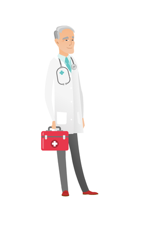 Senior caucasian doctor in medical gown holding first aid box. Friendly doctor standing with first aid kit. Doctor carrying first aid box. Vector flat design illustration isolated on white background.