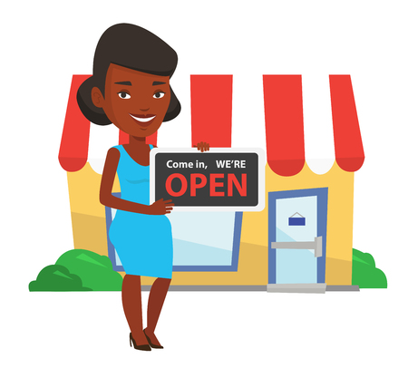 African-american shop owner holding open signboard. Young shop owner standing in front of small store. Woman inviting to come in her shop. Vector flat design illustration isolated on white background.