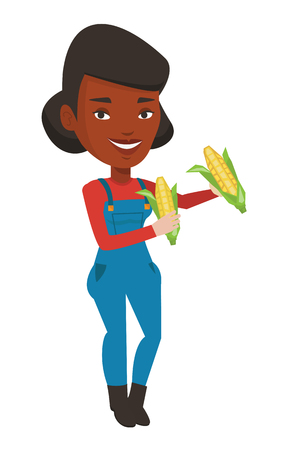Smiling african-american farmer collecting corn. Happy female farmer holding a corn cob. Cheerful farmer standing with a corn cob in hands. Vector flat design illustration isolated on white background