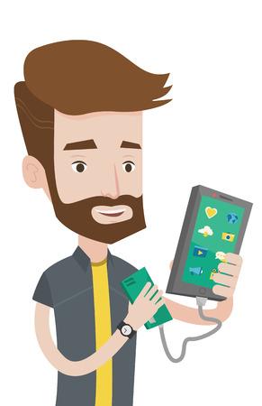 Glimlachende hipster mens die zijn smartphone met mobiele telefoon draagbare batterij aanvulling Jonge man met een mobiele telefoon en een draagbare batterij. Vector platte ontwerp illustratie op een witte achtergrond. Stockfoto - 83343155