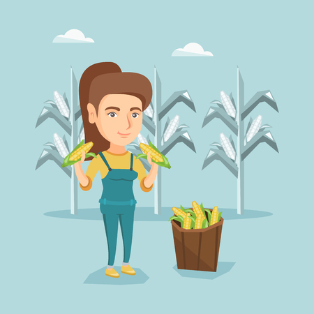 Farmer collecting corn. Happy smiling farmer standing near basket with corn.