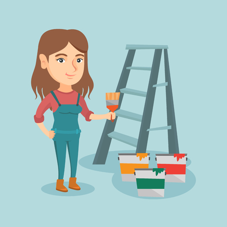 interior decoration: House painter holding a paintbrush. House painter with a paintbrush in hand standing near step-ladder and paint cans. Concept of house renovation.