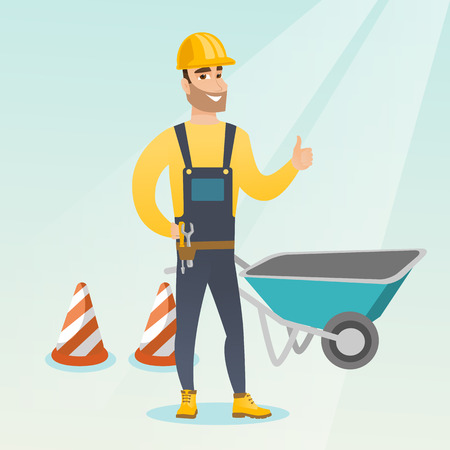 Caucasian builder with thumb up standing near wheelbarrow and traffic cones.