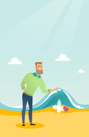 Caucasian man showing plastic bottles under water of sea.