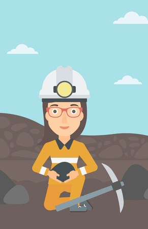 A woman sitting with coal in hands and a pickaxe on the background of coal mine vector flat design illustration. Vertical layout. Stock Illustratie