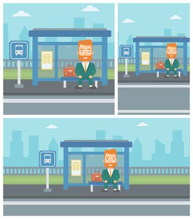앉아있는 동안 창 고에서 들어오는 버스를 기다리는 수염 난된 남자.