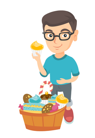 Little caucasian boy holding a yummy cupcake and stroking his belly. Happy boy in glasses standing near the bowl full of sweets. Vector sketch cartoon illustration isolated on white background.