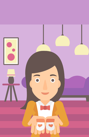 A pregnant woman holding baby booties in hands on the background of living room vector flat design illustration. Vertical layout.