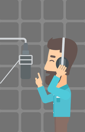 A hipster man in headphones making a record of his voice in studio vector flat design illustration. Vertical layout.