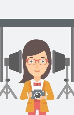 cartoon umbrella: A woman holding a camera on the background of photo studio with lighting equipment vector flat design illustration. Illustration