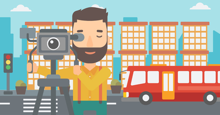 A hipster cameraman with the beard looking through movie camera on a city background vector flat design illustration. Illustration