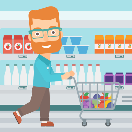 A hipster man with the beard pushing a supermarket cart with some goods in it on the background of supermarket shelves with products vector flat design illustration. Square layout. Illustration