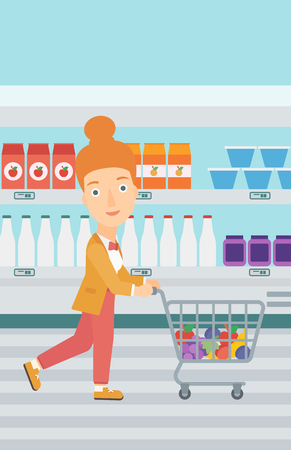 A woman pushing a supermarket cart with some goods in it on the background of supermarket shelves with products vector flat design illustration. Vertical layout. Illustration