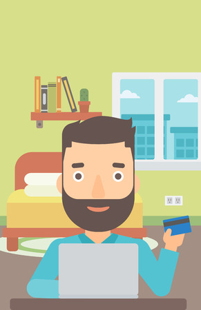 A hipster man with the beard sitting in front of laptop with credit card in hand and making purchases online on the background of bedroom vector flat design illustration. Vertical layout.