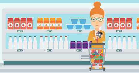 A woman standing near shopping cart and holding a calculator in hands on the background of supermarket shelves with products vector flat design illustration. Horizontal layout. Illustration