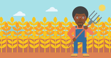 An african-american man standing with a pitchfork on the background of wheat field vector flat design illustration. Horizontal layout.