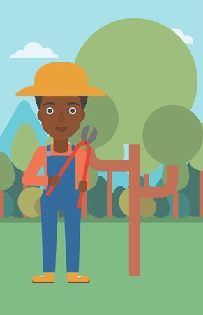 prune: An african-american woman holding a pruner on a background of garden with trees vector flat design illustration. Vertical layout. Illustration
