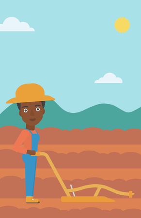 An african-american woman using a plough on the background of plowed agricultural field vector flat design illustration. Vertical layout.