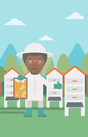 An african-american man wearing protective suit holding a framework in hand and showing thumb up on the background of apiary vector flat design illustration. Vertical layout. Ilustração