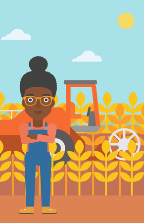 An african-american woman standing on the background of combine harvesting wheat vector flat design illustration. Vertical layout.