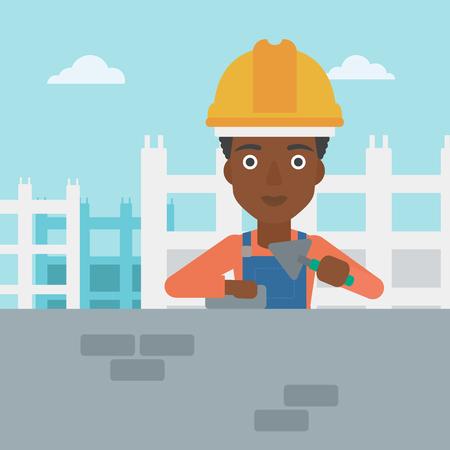An african-american female bricklayer with a spatula and a brick in hands on a background of construction site vector flat design illustration. Square layout. Illustration