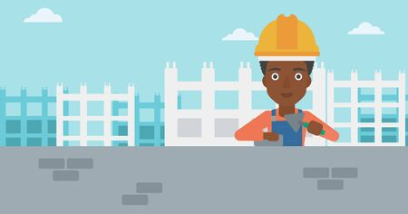 labourer: An african-american female bricklayer with a spatula and a brick in hands on a background of construction site vector flat design illustration. Horizontal layout. Illustration