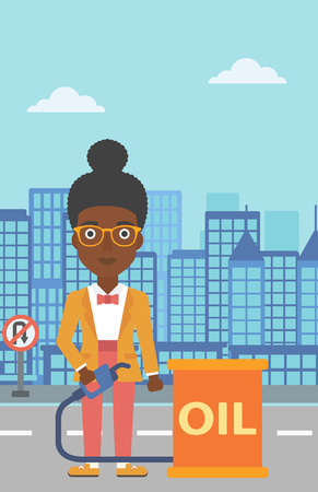 barril de petróleo: An african-american woman standing beside the oil can and holding filling nozzle on a city background vector flat design illustration. Vertical layout. Vectores