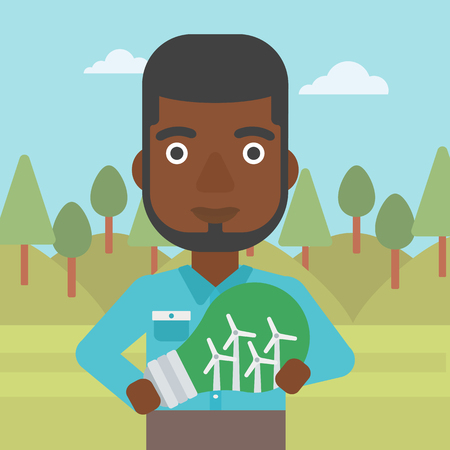 An african-american man standing on the background of green forest and holding in hands a big light bulb with small wind turbines inside vector flat design illustration. Square layout.